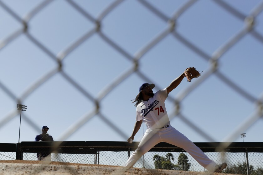 Dodgers relief pitcher Kenley Jansen throws during spring training on Feb. 20 in Phoenix.