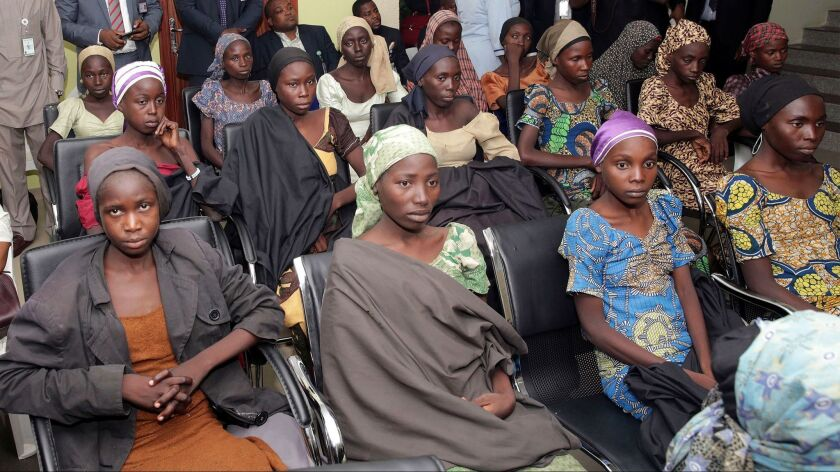 In this file photo released by the Nigeria State House, Chibok schoolgirls recently freed from Islamic extremist captivity are seen during a meeting with Nigerian Vice President Yemi Osinbajo in Abuja, Nigeria.