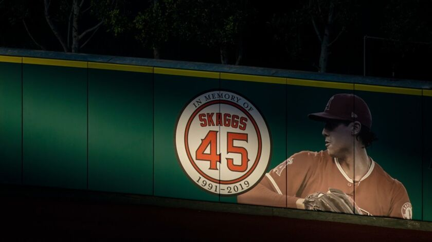 A tribute to the late Tyler Skaggs adorns the outfield wall at Angel Stadium.
