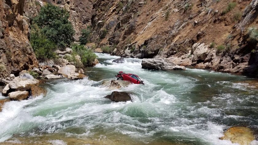 The bodies of two Thai students are believed to be trapped in a car stuck in the middle of the Kings River.