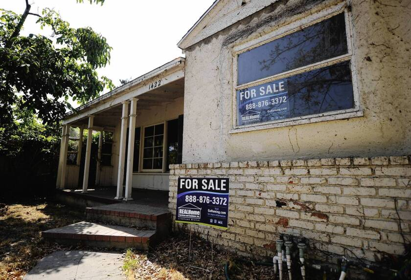 Under the settlement, banks were required to give homeowners aid in the form of principal reduction, short sales and other modifications. Above, a foreclosed house is up for sale last year in Glendale.