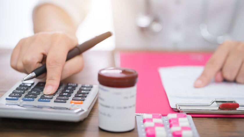 Calculate drug cost.,doctor is calculating cost of treatment
