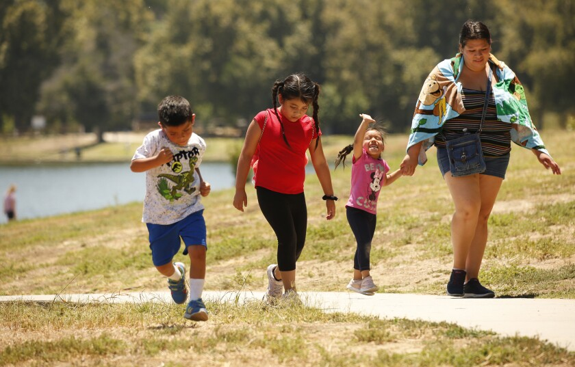 ENCINO, CA - JULY 12, 2019 - Vanessa Santos walks her children Keily, 7, Kevin, 4, and Cecelia, 3, a