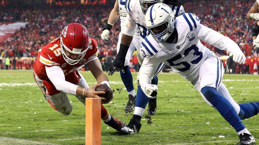 Chiefs quarterback Patrick Mahomes dives for the goal line to score a touchdown against the Colts on a four-yard run Saturday.