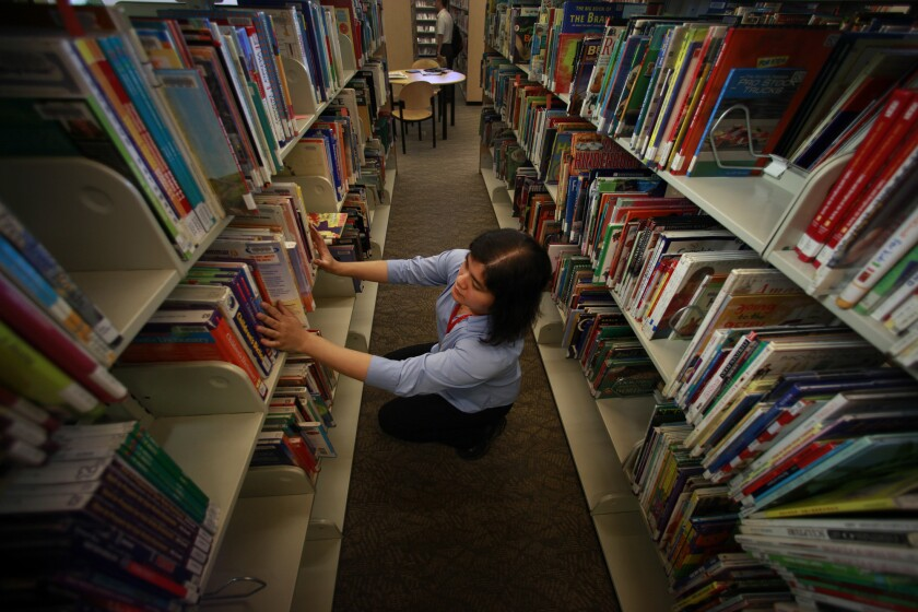 Organizing the bookshelves at the Los Angeles Public Library.