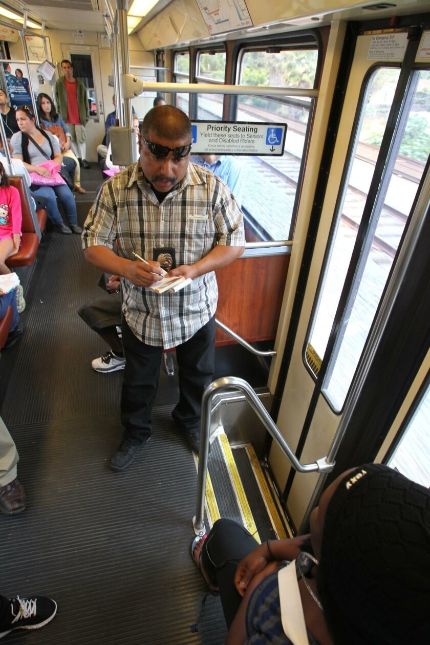 Trolley Code Compliance Officer Sgt. Marco Rico cited a woman for not having a valid ticket on the southbound Trolley.