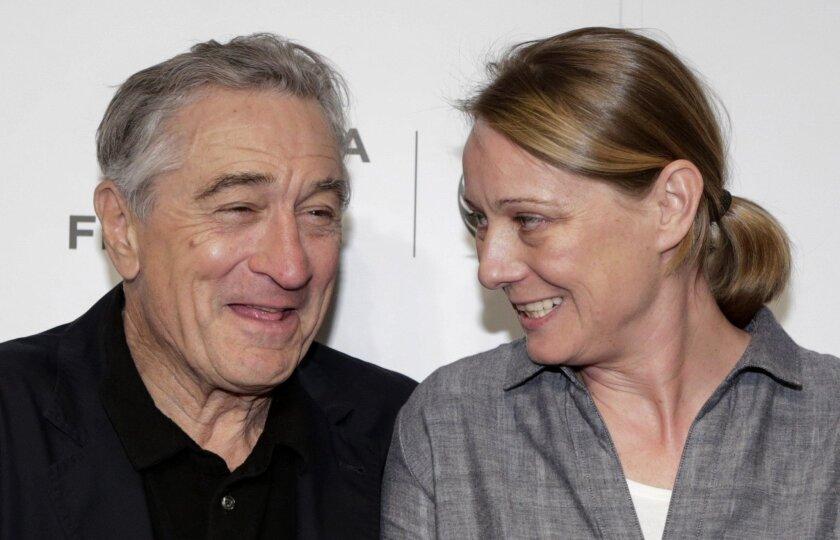 "Tribeca Film Festival Co-founder Robert De Niro and director Camilla Nielsson, whose film ""Democrats"" scored the prize for documentary, share a moment after the Tribeca Film Festival awards ceremony."