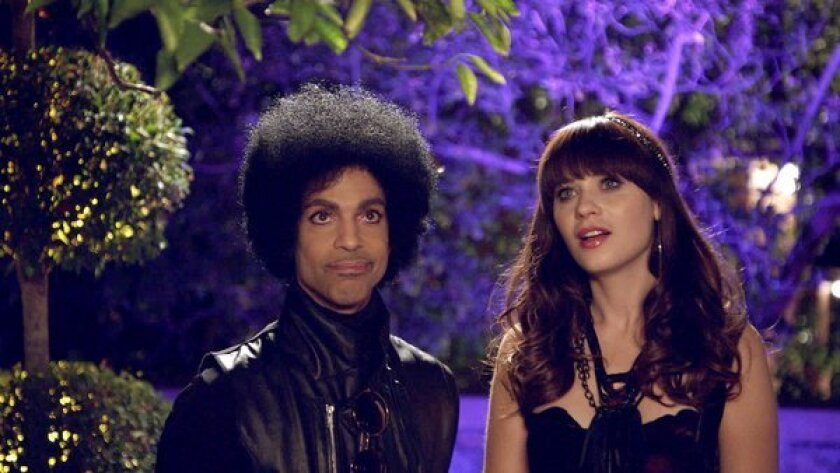 """Prince with Zooey Deschanel on Fox's """"New Girl."""""""