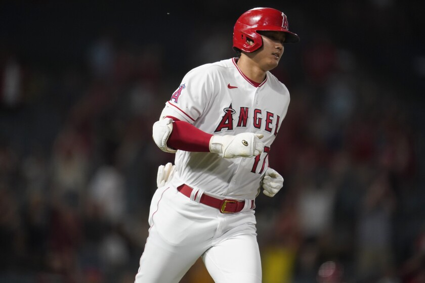 Angels' Shohei Ohtani rounds first base after a solo home run.