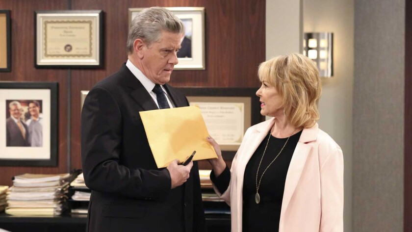 """Sam McMurray and Roseanne Barr in """"Cristela"""" on ABC."""