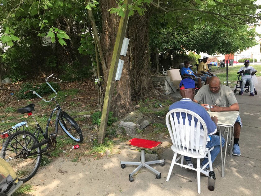 In the Uptown neighborhood of New Orleans last weekend, people who knew some of those with COVID-19 who had died gathered as usual under a community tree.