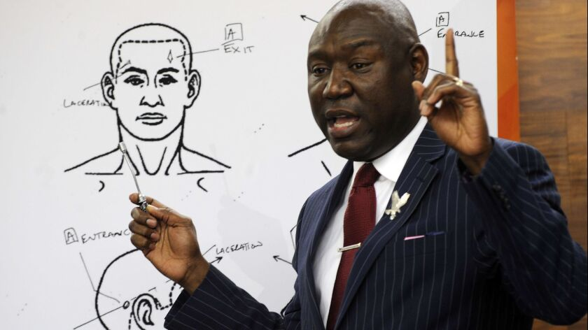 """Attorney Ben Crump discusses the results of a forensic examination on Emantic """"EJ"""" Bradford Jr., who was fatally shot by police in a shopping mall on Thanksgiving, during a news conference in Birmingham, Ala., on Monday."""