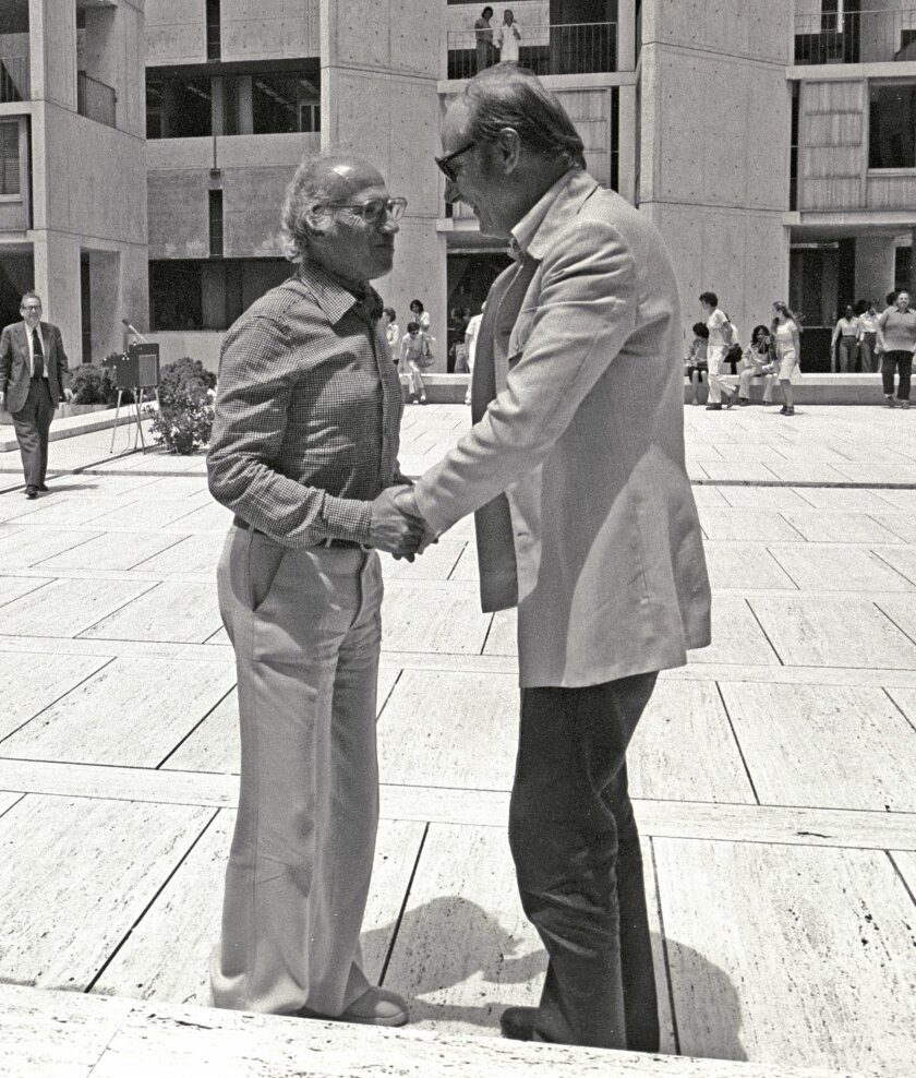 Jonas Salk (left) and Francis Crick talk in the courtyard of the Salk Institute for Biological Studies in La Jolla. Crick became a non-resident fellow of the Salk even before the institute was built.