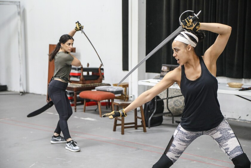 """Cast members Ulka Simone Mohanty (left) and Devereau Chumrau work on a fight sequence from San Diego Rep's """"House of Joy."""""""