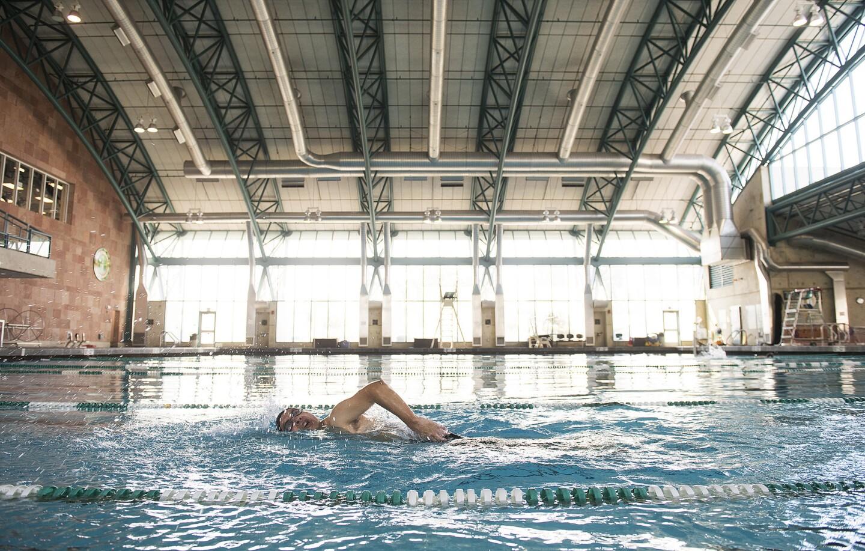 A man swims at the Brenda Villa Aquatic Center in the city of Commerce.