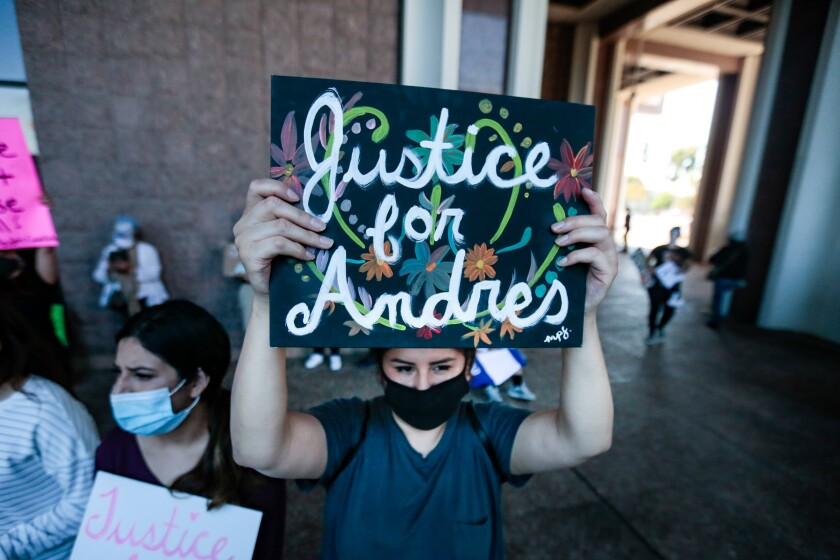 Demonstrators rally outside the L.A. County sheriff's station in Compton to protest the shooting death of Andres Guardado.