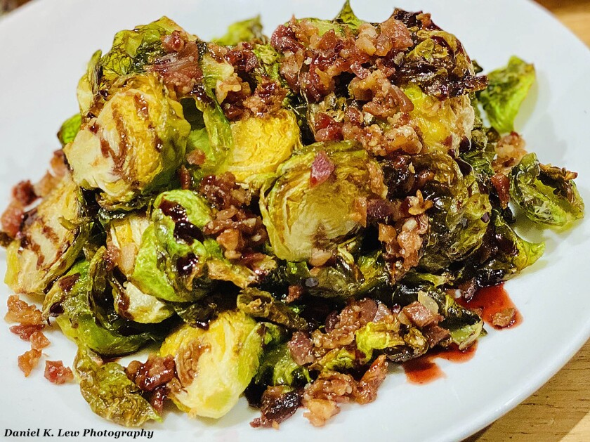Sauteed brussel sprouts topped with bacon and boysenberry balsamic is among the unique foods offered during Knott's Boysenberry Festival, March 20-April 19, 2020 at Knott's Berry Farm theme park in Buena Park, California.