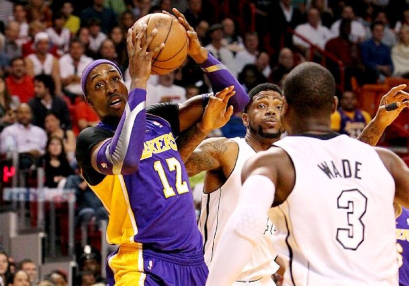 Dwight Howard battles against the Miami Heat
