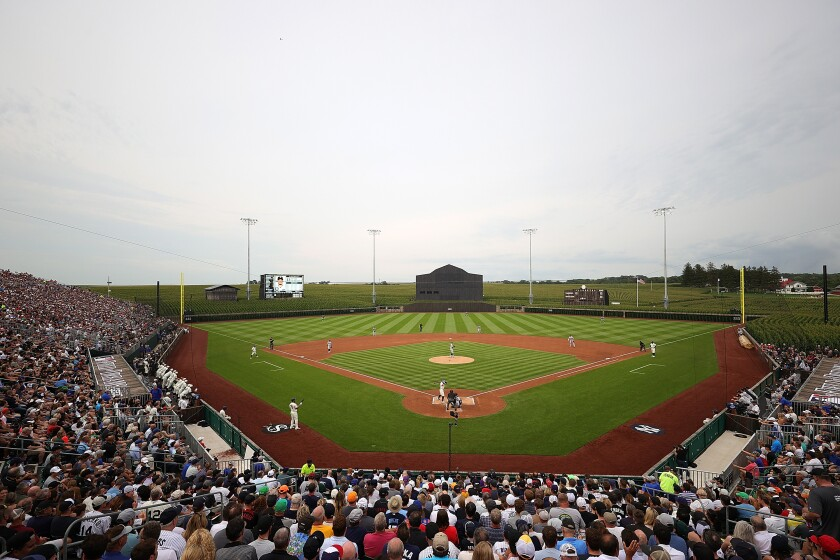"""Spectators watch  the """"Field of Dreams"""" game between the Chicago White Sox and the New York Yankees"""