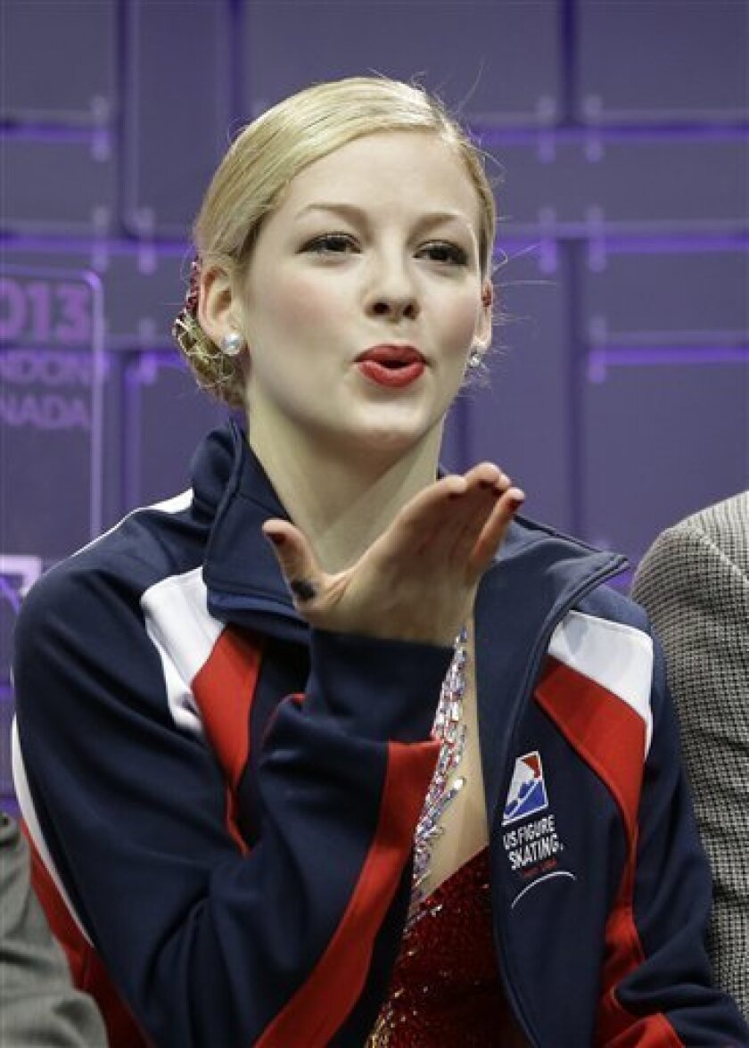 Gracie Gold of the United States blows a kiss as she watches her scores during the ladies short program at the World Figure Skating Championships Thursday, March 14, 2013, in London, Ontario. (AP Photo/Darron Cummings) .