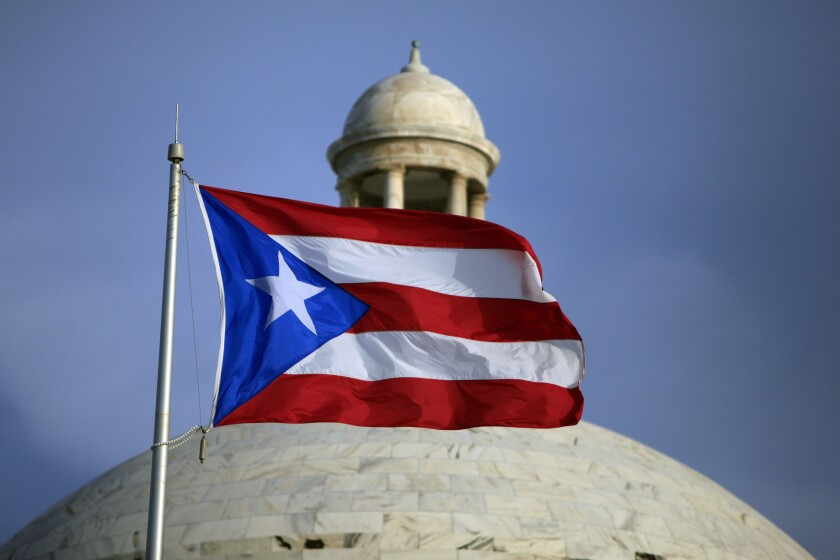 The Puerto Rican flag flies in front of the commonwealth's Capitol in San Juan.