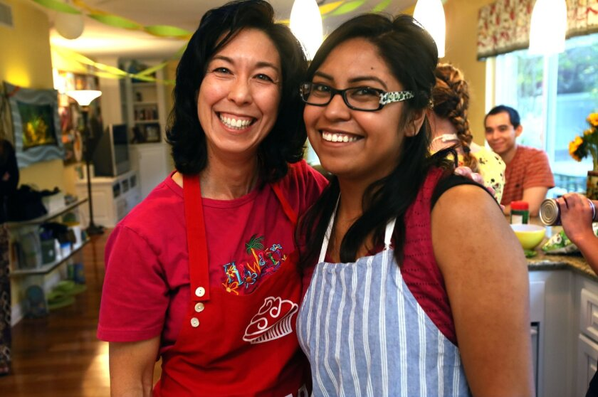 Guardian Scholars mentor Valerie Wentworth, left, with Cal State San Marcos senior Sandra Ramirez at Valerie's Scripps Ranch home in February. They made homemade pizza that afternoon to celebrate Ramirez's 24th birthday.