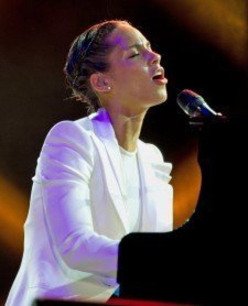 Alicia Keys performing at Monster Retailer Awards.