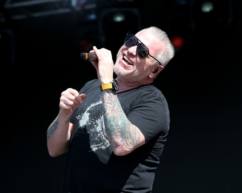 Steve Harwell of Smash Mouth performing on stage.