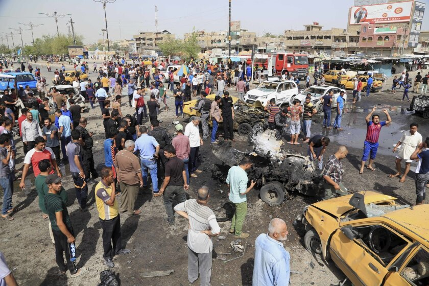 Car bombing aftermath in Baghdad