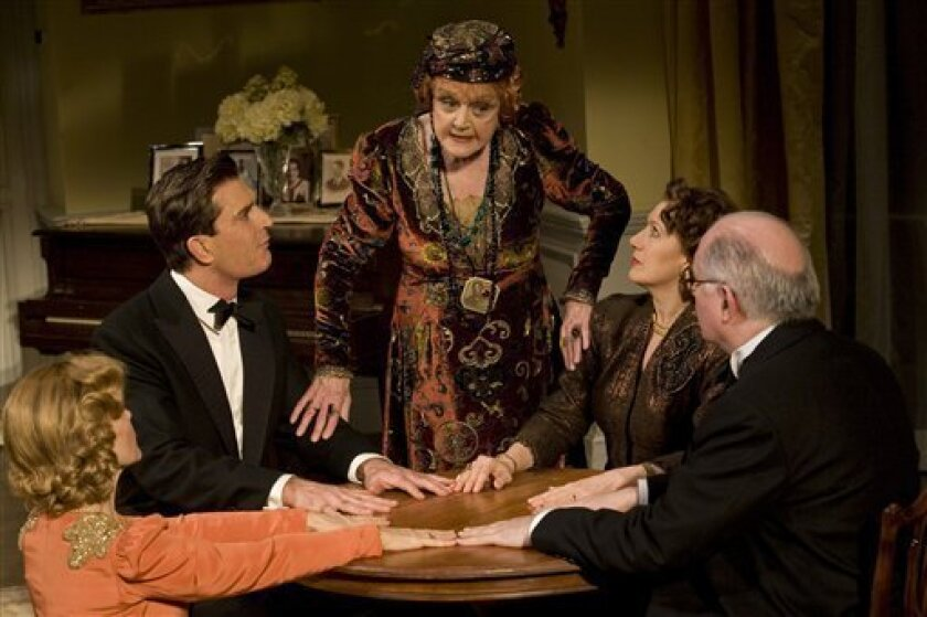 "In this image released by Jeffrey Richards Associates, actors, from left, Deborah Rush, Rupert Everett, Angela Lansbury, Jayne Atkinson and Simon Jones are shown in a scene from the revival of Noel Coward's ""Blithe Spirit,"" now playing at Broadway's Shubert Theatre in New York. (AP Photo/Jeffrey Ri"