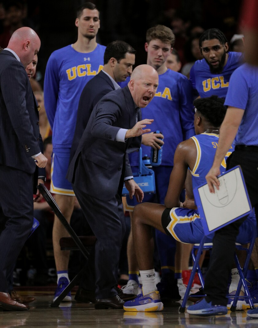 UCLA coach Mick Cronin has words for his players after defensive lapses against USC in the second half at Galen Center on Saturday.