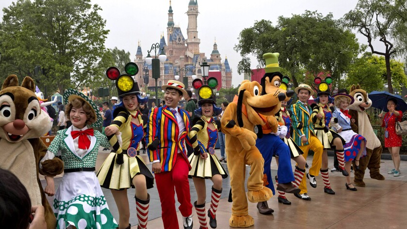 Performers take part in a parade at the Disney Resort in Shanghai on June 15, 2016, on the eve of the park's grand opening. Disney will open its first resort in mainland China on June 16.