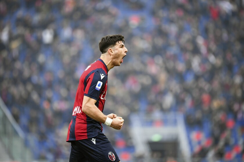 Bologna's Riccardo Orsolini celebrates after scoring his side's equalizing goal during a Serie A soccer match between Bologna and Brescia, in Bologna, Italy, Saturday, Feb. 1, 2020. (Massimo Paolone/LaPresse via AP)