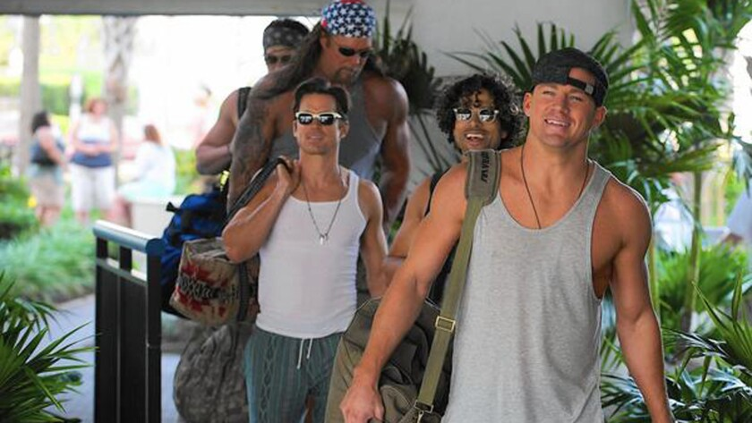 "Magic Mike (Channing Tatum), front, leads his stripper crew on a road trip to Myrtle Beach, S.C., in ""Magic Mike XXL."""