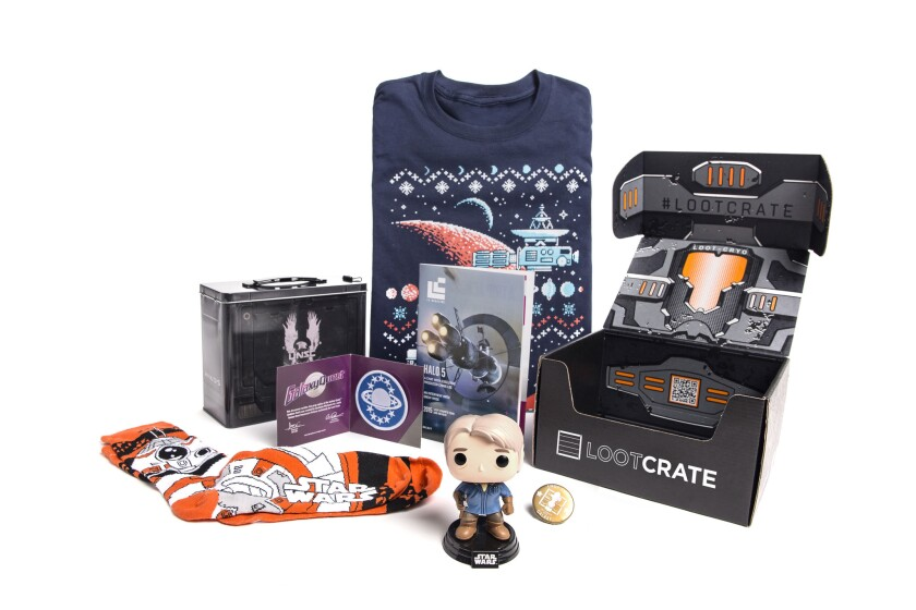 """Items from a """"Star Wars""""-themed Loot Crate box included socks, a T-shirt and a figurine."""
