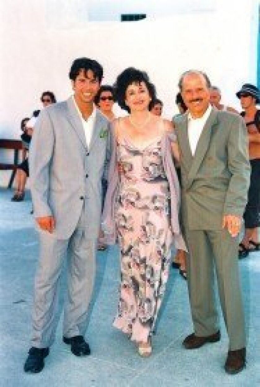Dean Grafos and his parents, Thean and Steven. Courtesy photo