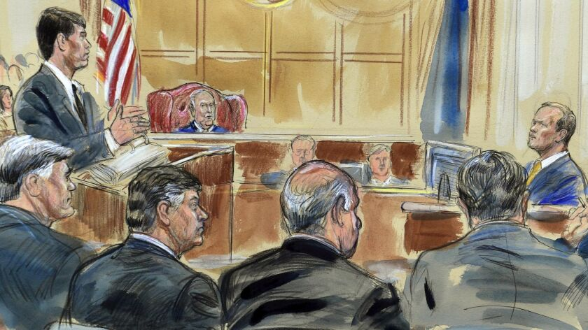 Richard Gates, right, answers questions from prosecutor Greg Andres in this courtroom sketch of the trial of Paul Manafort, seated second from left.