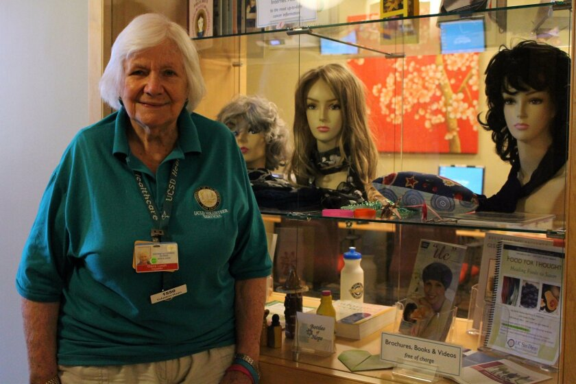 Volunteer Gloria Lynch helps out in the Moores Cancer Center Infusion Center's resource room.