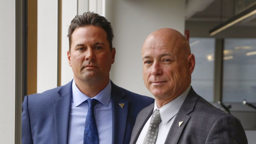 San Diego Police Detectives, Ross Weaver, left, and Odie Gallop, right. (Howard Lipin / San Diego Union-Tribune)