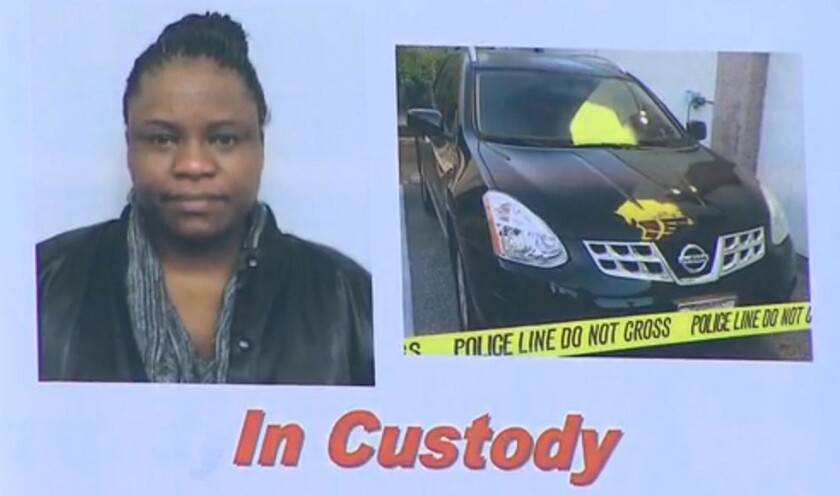 Tiffani Lowden, 38, of Whittier turned herself in Monday night in a South Pasadena collision that injured a family of three and killed their dog, police said.