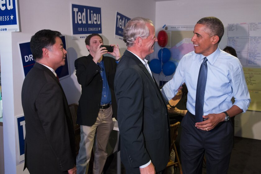 President Barack Obama, right, talks with Rep. Steve Israel (D-N.Y.) during a visit to the campaign office State Senator Ted Lieu, left, who is running for Congress.