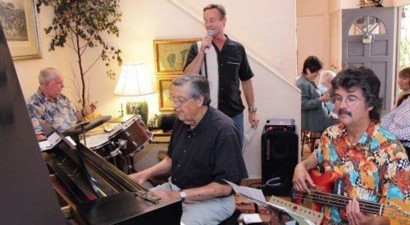 Jack Wheaton on piano, Rob Morgan on vocals, Dana Wheaton on bass guitar