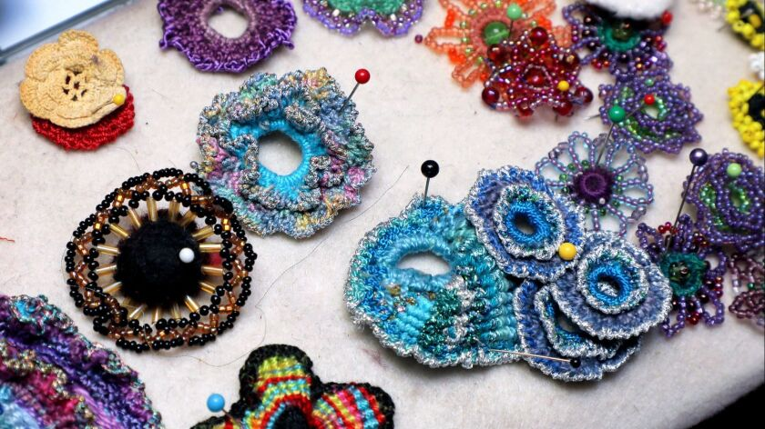 Detail view of some of the intricate needlelace work by artist Rita Zurell in her home studio in Escondido.
