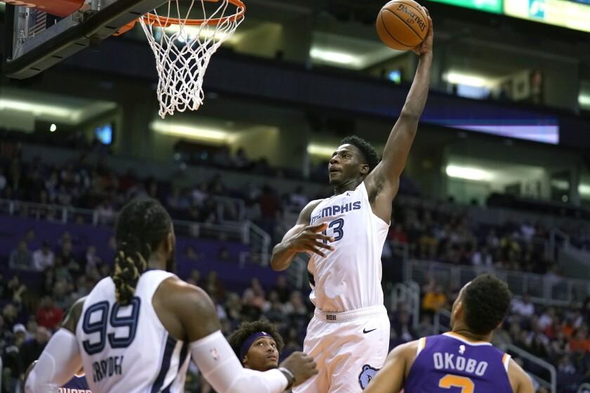 Memphis Grizzlies forward Jaren Jackson Jr. (13) dunks against the Phoenix Suns in the first half during an NBA basketball game, Sunday, Jan. 5, 2020, in Phoenix. (AP Photo/Rick Scuteri)
