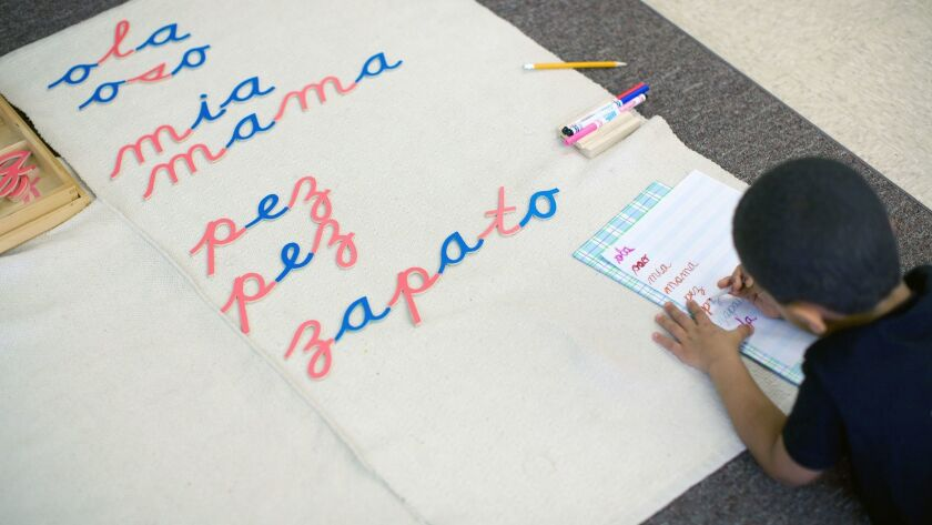 At LePort Montessori's Huntington Beach school, a preschool student writes in Spanish using the Mo