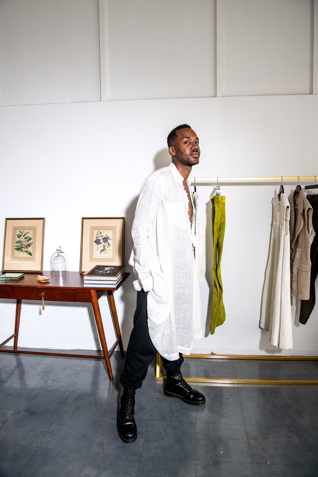 Kenneth Nicholson wears a white gauze Dorcas tunic with paired with black vintage sweatpants.