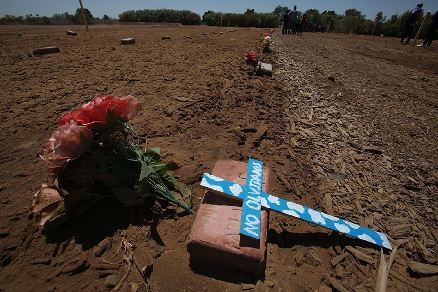 Dirt lot holds remains of deadly migrant crossings - The San Diego
