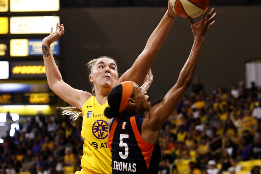 Sparks center Maria Vadeeva blocks a shot by Sun guard Jasmine Thomas during Game 3 on Sunday.
