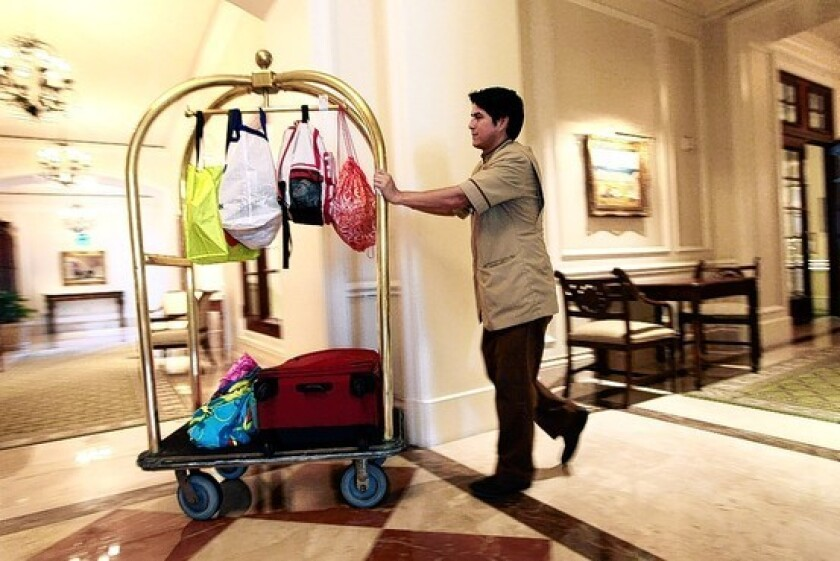 The travel industry has recovered all of the jobs it lost during the recession, according to new employment statistics. Above, a bellman at the Ritz-Carlton in Key Biscayne, Fla., in 2010.