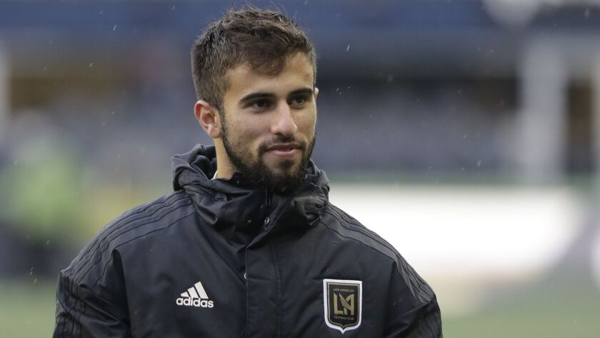 Los Angeles forward Diego Rossi walks off the pitch after an MLS soccer match against the Seattle So